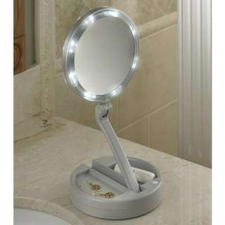 The Foldaway Lighted Vanity Mirror  Hammacher Schlemmer