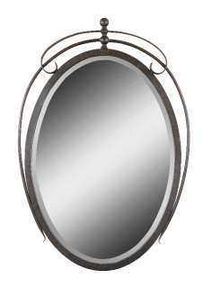 This oval shaped wall mirror features a frame made of hand forged