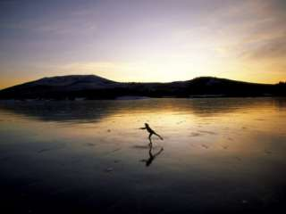 Silhouette of a Person Ice Skating Photographic Print at AllPosters